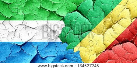 Sierra Leone flag with congo flag on a grunge cracked wall