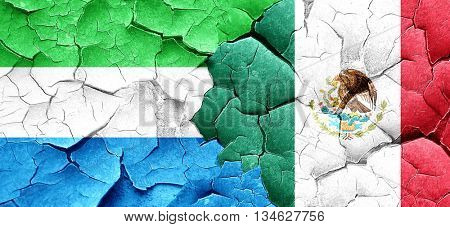 Sierra Leone flag with Mexico flag on a grunge cracked wall