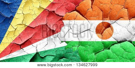 seychelles flag with Niger flag on a grunge cracked wall