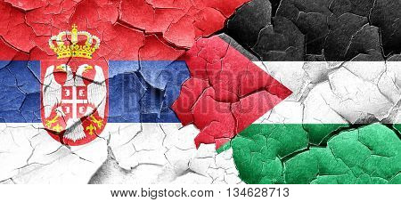 Serbia flag with Palestine flag on a grunge cracked wall