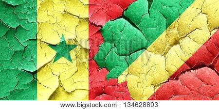 Senegal flag with congo flag on a grunge cracked wall