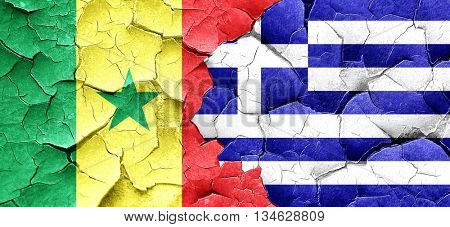 Senegal flag with Greece flag on a grunge cracked wall
