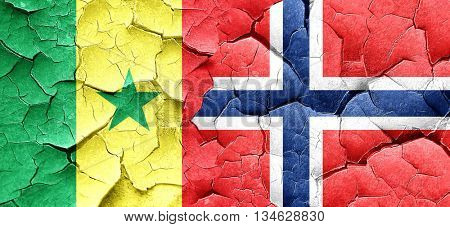 Senegal flag with Norway flag on a grunge cracked wall