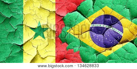 Senegal flag with Brazil flag on a grunge cracked wall