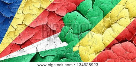 seychelles flag with congo flag on a grunge cracked wall