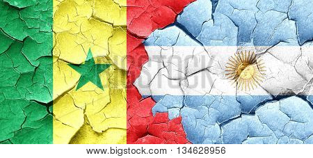 Senegal flag with Argentine flag on a grunge cracked wall