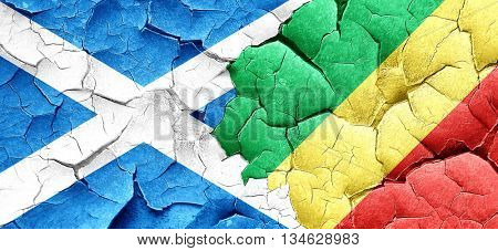 scotland flag with congo flag on a grunge cracked wall