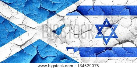 scotland flag with Israel flag on a grunge cracked wall