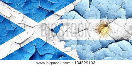 scotland flag with Argentine flag on a grunge cracked wall