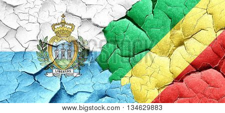 san marino flag with congo flag on a grunge cracked wall