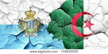 san marino flag with Algeria flag on a grunge cracked wall