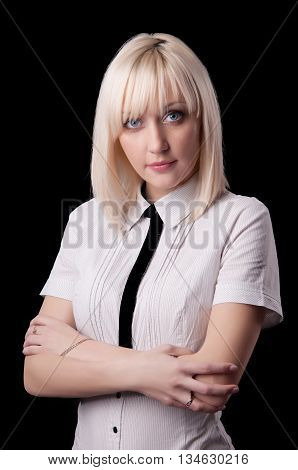 Business woman with arms folded looking at camera