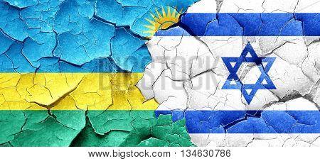 Rwanda flag with Israel flag on a grunge cracked wall