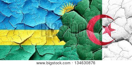 Rwanda flag with Algeria flag on a grunge cracked wall