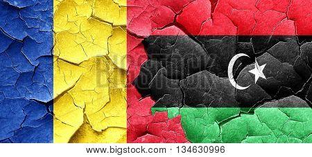 Romania flag with Libya flag on a grunge cracked wall