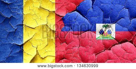 Romania flag with Haiti flag on a grunge cracked wall