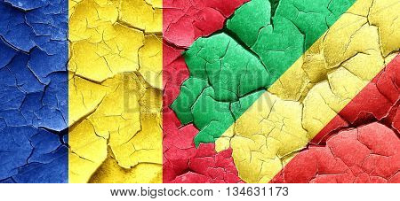 Romania flag with congo flag on a grunge cracked wall
