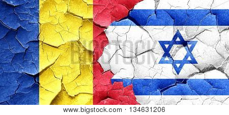Romania flag with Israel flag on a grunge cracked wall