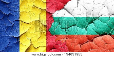 Romania flag with Bulgaria flag on a grunge cracked wall