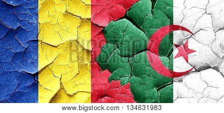 Romania flag with Algeria flag on a grunge cracked wall