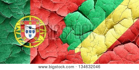 Portugal flag with congo flag on a grunge cracked wall