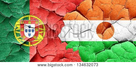 Portugal flag with Niger flag on a grunge cracked wall