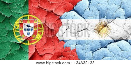 Portugal flag with Argentine flag on a grunge cracked wall