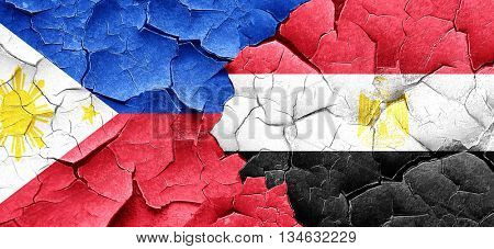 Philippines flag with egypt flag on a grunge cracked wall
