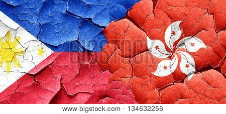 Philippines flag with Hong Kong flag on a grunge cracked wall