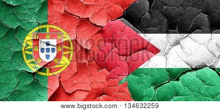 Portugal flag with Palestine flag on a grunge cracked wall