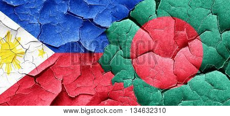 Philippines flag with Bangladesh flag on a grunge cracked wall