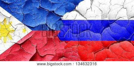Philippines flag with Russia flag on a grunge cracked wall
