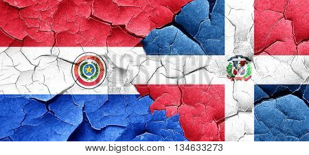 Paraguay flag with Dominican Republic flag on a grunge cracked w