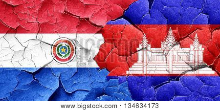 Paraguay flag with Cambodia flag on a grunge cracked wall