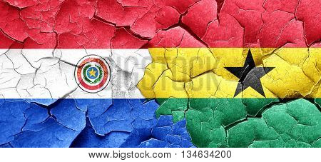 Paraguay flag with Ghana flag on a grunge cracked wall