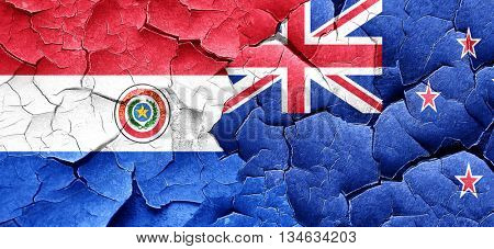 Paraguay flag with New Zealand flag on a grunge cracked wall