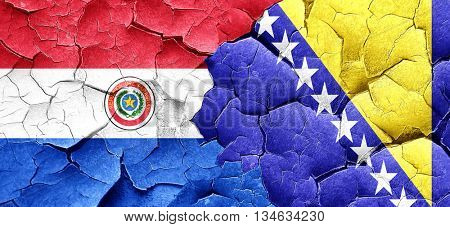 Paraguay flag with Bosnia and Herzegovina flag on a grunge crack