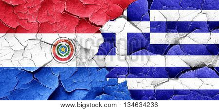 Paraguay flag with Greece flag on a grunge cracked wall