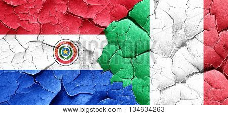 Paraguay flag with Italy flag on a grunge cracked wall
