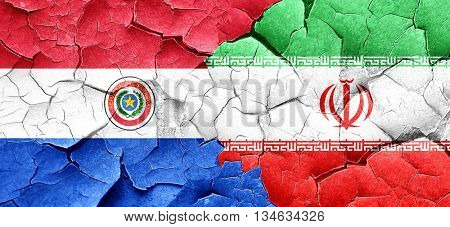 Paraguay flag with Iran flag on a grunge cracked wall