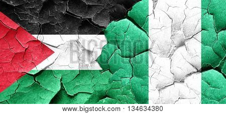 palestine flag with Nigeria flag on a grunge cracked wall