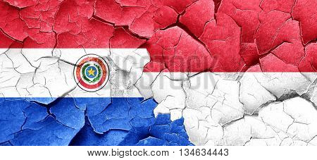 Paraguay flag with Indonesia flag on a grunge cracked wall