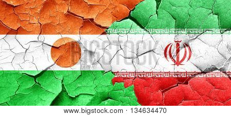 niger flag with Iran flag on a grunge cracked wall