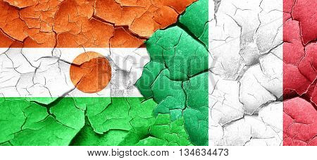 niger flag with Italy flag on a grunge cracked wall