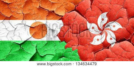 niger flag with Hong Kong flag on a grunge cracked wall