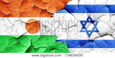 niger flag with Israel flag on a grunge cracked wall