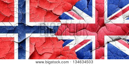 norway flag with Great Britain flag on a grunge cracked wall