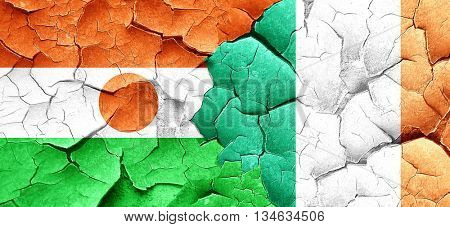 niger flag with Ireland flag on a grunge cracked wall