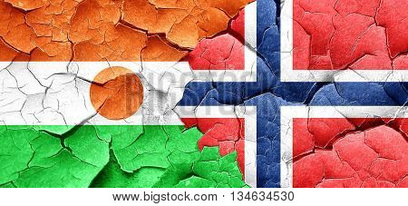 niger flag with Norway flag on a grunge cracked wall