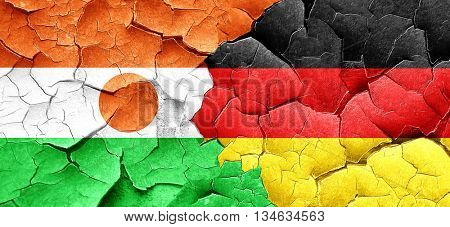 niger flag with Germany flag on a grunge cracked wall